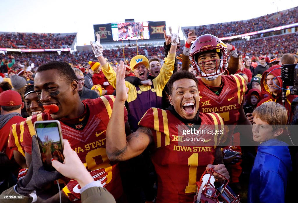 Wide receiver Deshaunte Jones #8, defensive back D'Andre Payne #1 of the Iowa State Cyclones, and wide receiver Allen Lazard #5 of the Iowa State Cyclones celebrates with fans after defeating the TCU Horned Frogs 14-7 in the second half of play at Jack Trice Stadium on October 28, 2017 in Ames, Iowa. The Iowa State Cyclones won 14-7 over the TCU Horned Frogs.