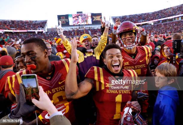 Wide receiver Deshaunte Jones defensive back D'Andre Payne of the Iowa State Cyclones and wide receiver Allen Lazard of the Iowa State Cyclones...