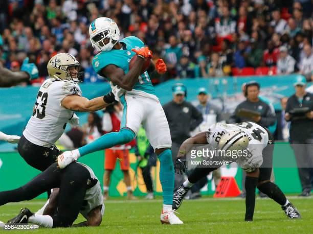 Wide receiver DeVante Parker of Miami Dolphins with a catch in from of linebacker AJ Klein of New Orleans Saints during the New Orleans Saints...