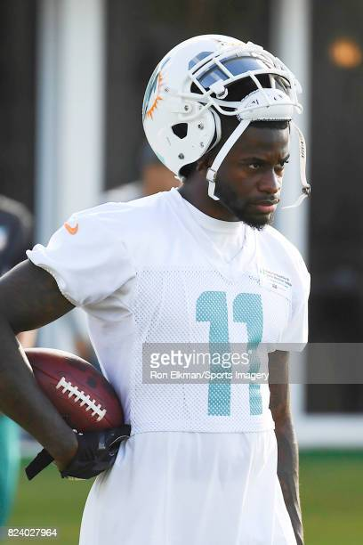 Wide receiver DeVante Parker of the Miami Dolphins looks on during training camp on July 27 2017 at the Miami Dolphins training facility in Davie...