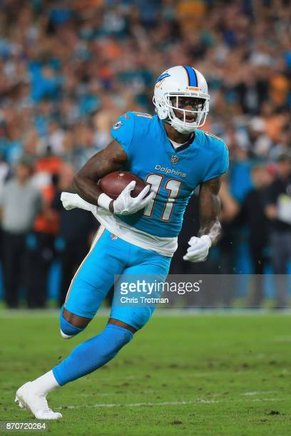 Wide receiver DeVante Parker of the Miami Dolphins runs with the ball against the Oakland Raiders at Hard Rock Stadium on November 5 2017 in Miami...