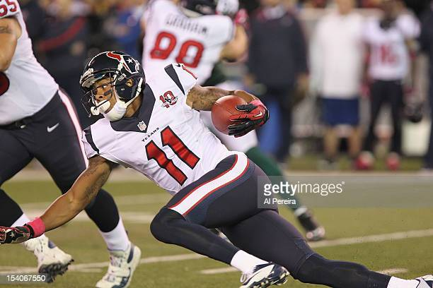Wide Receiver DeVier Posey of the Houston Texans has a long gain against the New York Jets as the Jets host the Texans on Monday Night Football at...