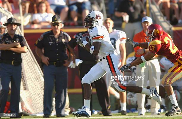 Wide receiver Devin Aromashodu of the Auburn Tigers races down the field just out of arms reach of cornerback Ronald Nunn of the USC Trojans at the...