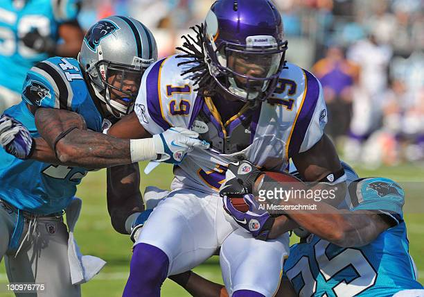 Wide receiver Devin Aromashodu of the Minnesota Vikings grabs a pass against the Carolina Panthers October 30 2011 at Bank of America Stadium in...
