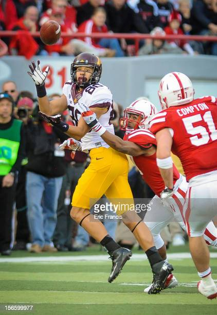Wide receiver Devin CrawfordTufts of the Minnesota Golden Gophers catches the ball in front of cornerback Ciante Evans of the Nebraska Cornhuskers...