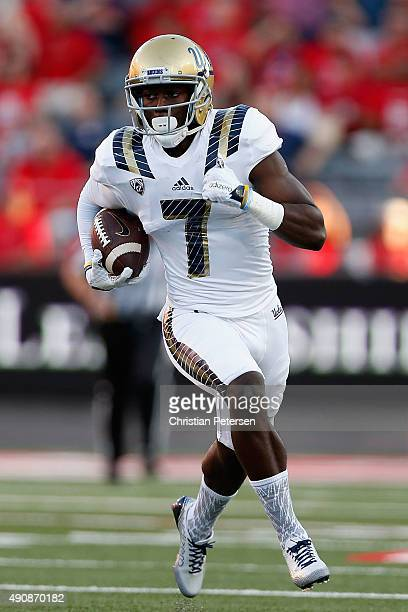 Wide receiver Devin Fuller of the UCLA Bruins runs with the football after a reception against the Arizona Wildcats during the college football game...