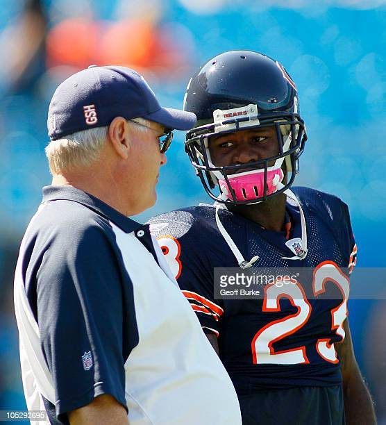 Wide receiver Devin Hester of the Chicago Bears talks with offensive coordinator Mike Martz prior to the Bears game against the Carolina Panthers at...