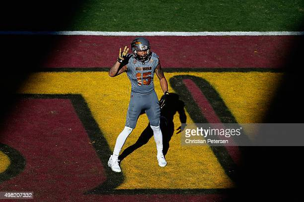 Wide receiver Devin Lucien of the Arizona State Sun Devils celebrates after scoring on a 59 yard touchdown reception against the Arizona Wildcats...