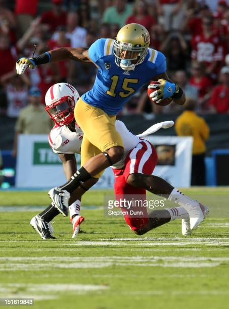 Wide receiver Devin Lucien of the UCLA Bruins carries the ball against the Nebraska Cornhuskers at the Rose Bowl on September 8 2012 in Pasadena...