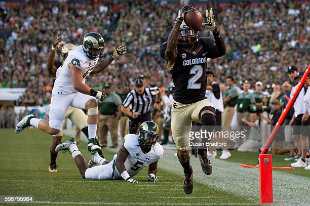 Wide receiver Devin Ross of the Colorado Buffaloes runs across the goal line for a first quarter touchdown reception against the Colorado State Rams...