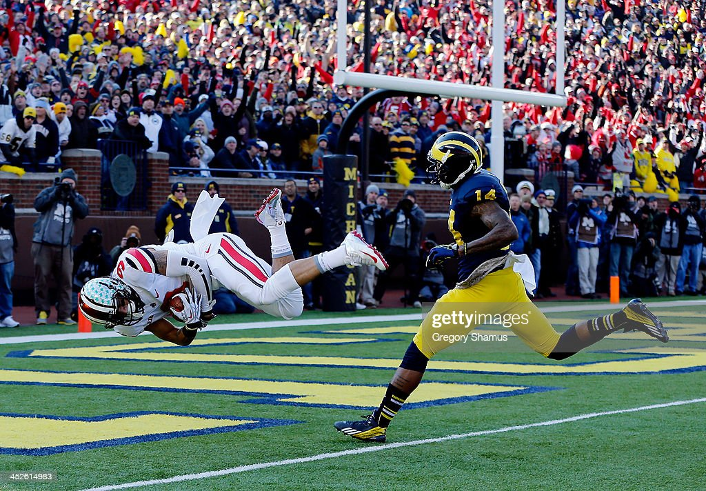 Wide receiver Devin Smith #9 of the Ohio State Buckeyes scores a touchdown in the first quarter as safety Josh Furman #14 of the Michigan Wolverines defends during a game at Michigan Stadium on November 30, 2013 in Ann Arbor, Michigan.