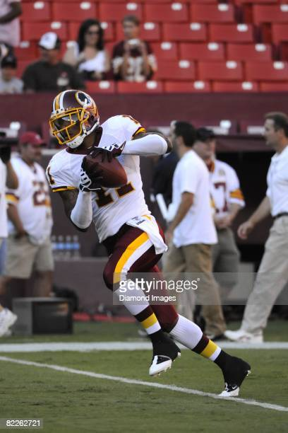 Wide receiver Devin Thomas 311 of the Washington Redskins catches a pass during drills prior to a preseason game on August 9, 2008 against the...