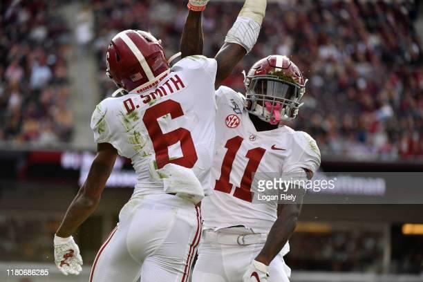 Wide receiver DeVonta Smith of the Alabama Crimson Tide celebrates with wide receiver Henry Ruggs III of the Alabama Crimson Tide after a touchdown...