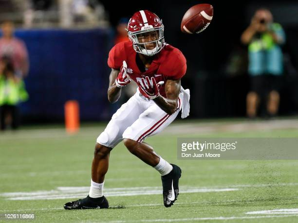 Wide Receiver DeVonta Smith of the Alabama Crimson Tide makes a catch during the game against the Louisville Cardinals during the Camping World...