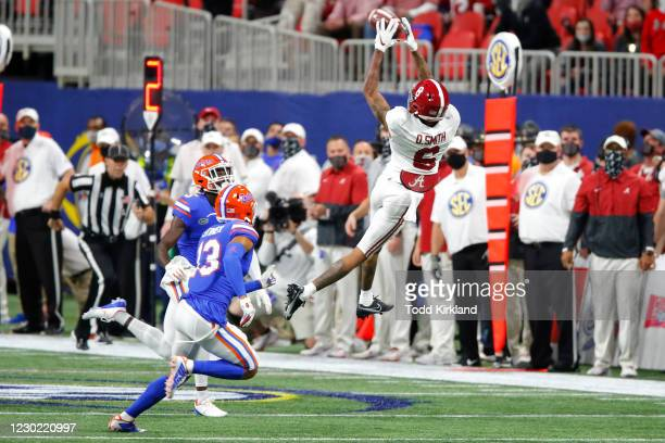 Wide receiver DeVonta Smith of the Alabama Crimson Tide makes a reception in the first half against the Florida Gators during the SEC Championship...