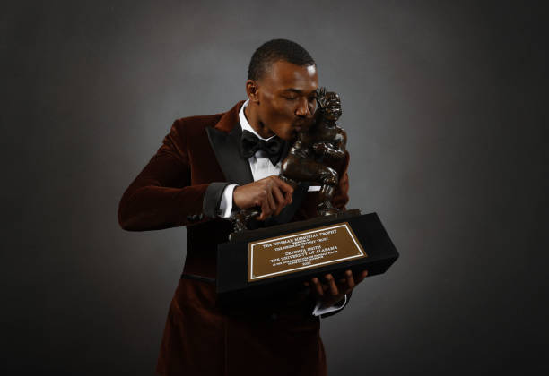 Wide receiver DeVonta Smith of the Alabama Crimson Tide poses with the Heisman Memorial Trophy on January 05, 2021 in New York, New York.