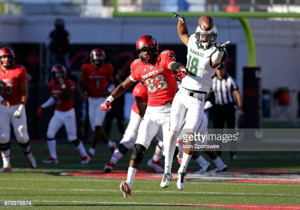 UNLV wide receiver Devonte Boyd and Hawaii cornerback Rojesterman Farris II make a play for the ball during a game on November 04 at Sam Boyd Stadium...