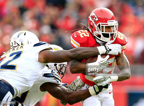Wide receiver Dexter McCluster of the Kansas City Chiefs carries the ball as inside linebacker Reggie Walker and cornerback Shareece Wright of the...
