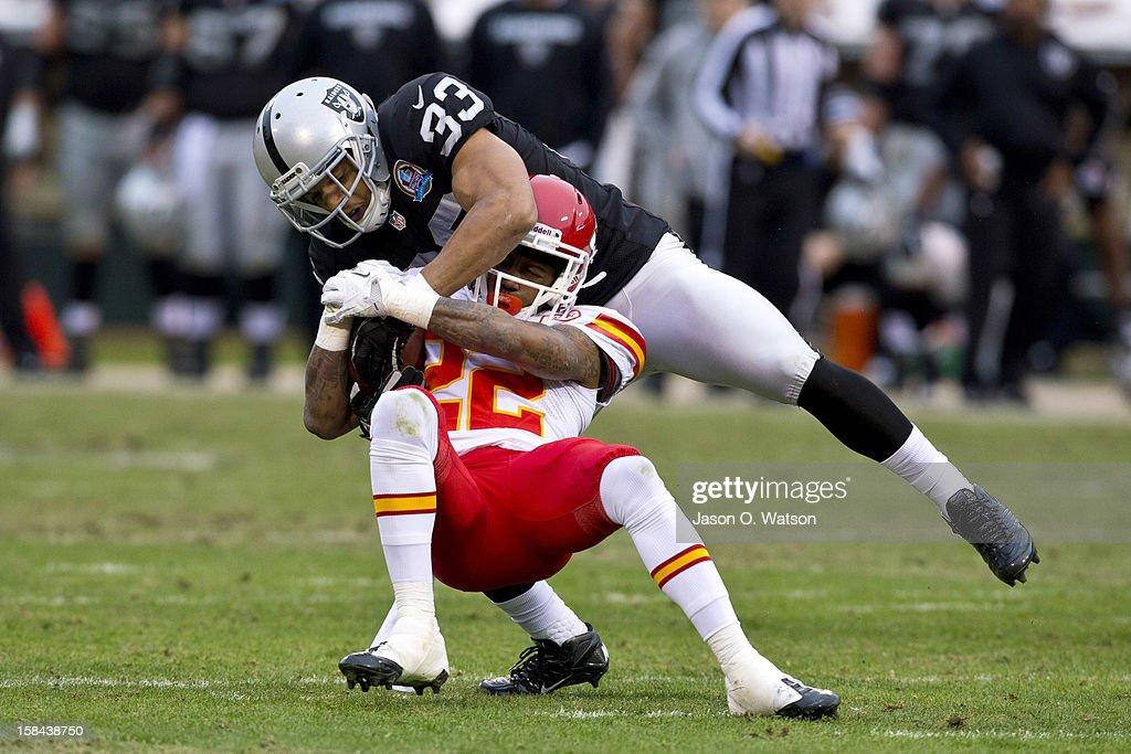 Wide receiver Dexter McCluster #22 of the Kansas City Chiefs is tackled by strong safety Tyvon Branch #33 of the Oakland Raiders after a pass reception during the third quarter at O.co Coliseum on December 16, 2012 in Oakland, California. The Oakland Raiders defeated the Kansas City Chiefs 15-0.