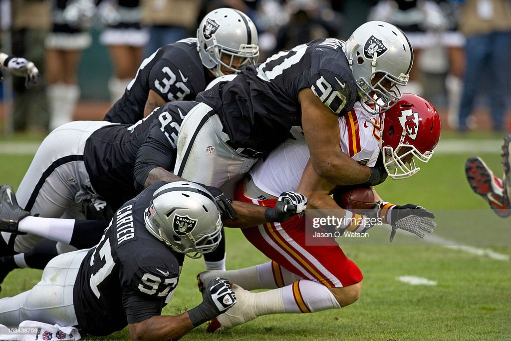 Wide receiver Dexter McCluster #22 of the Kansas City Chiefs is tackled by defensive tackle Desmond Bryant #90 of the Oakland Raiders during the first quarter at O.co Coliseum on December 16, 2012 in Oakland, California.