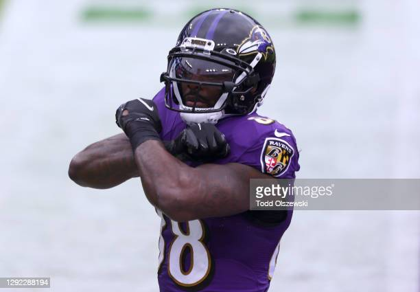 Wide receiver Dez Bryant of the Baltimore Ravens celebrates following an 11-yard touchdown reception during the second quarter of their game against...