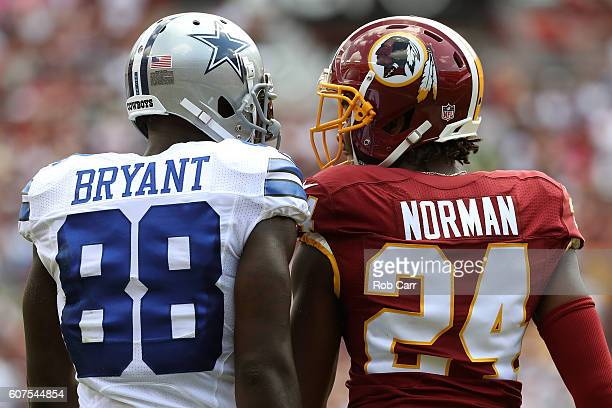 Wide receiver Dez Bryant of the Dallas Cowboys argues with cornerback Josh Norman of the Washington Redskins during the first quarter at FedExField...