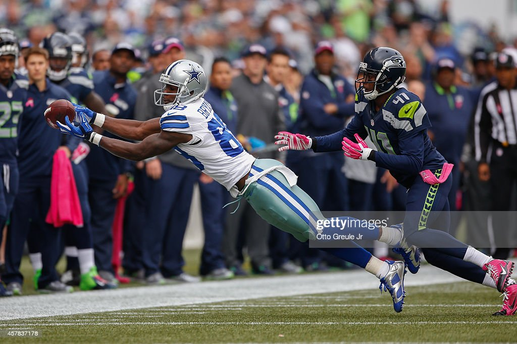 Wide receiver Dez Bryant #88 of the Dallas Cowboys attempts to make a catch against defensive back Byron Maxwell #41 of the Seattle Seahawks at CenturyLink Field on October 12, 2014 in Seattle, Washington.
