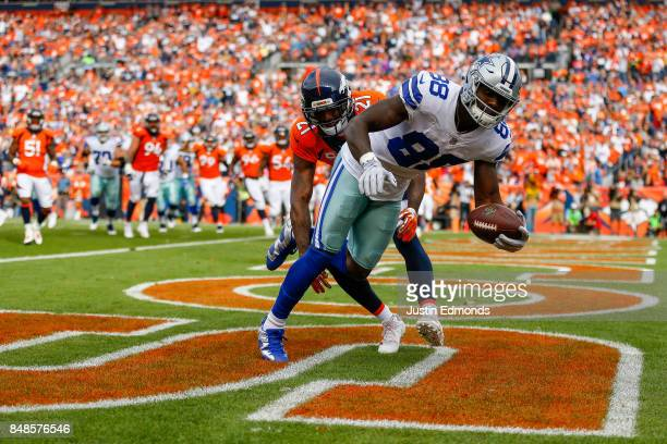 Wide receiver Dez Bryant of the Dallas Cowboys has a 3 yard touchdown reception in the second quarter of a game against the Denver Broncos at Sports...