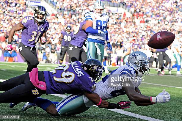 Wide receiver Dez Bryant of the Dallas Cowboys is hit by cornerback Cary Williams of the Baltimore Ravens as he misses a two-point conversion that...