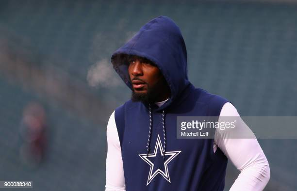 Wide receiver Dez Bryant of the Dallas Cowboys looks on during warmups before playing against the Philadelphia Eagles at Lincoln Financial Field on...
