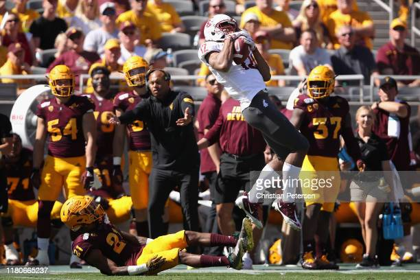Wide receiver Dezmon Patmon of the Washington State Cougars catches a deep pass over defensive back Jack Jones of the Arizona State Sun Devils during...
