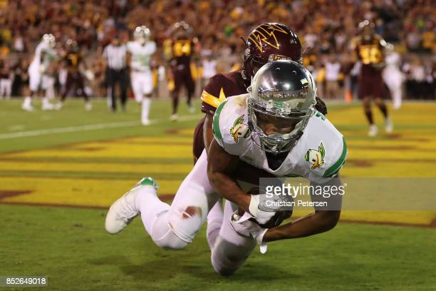 Wide receiver Dillon Mitchell of the Oregon Ducks catches a seven yard touchdown reception against the Arizona State Sun Devils during the first half...