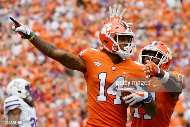 Wide receiver Diondre Overton of the Clemson Tigers celebrates with wide receiver Cornell Powell after catching a touchdown pass against the Furman...