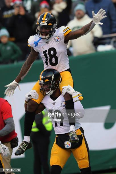 Wide Receiver Diontae Johnson of the Pittsburgh Steelers scores a Touchdown and gets a ride on Wide Receiver JuJu SMith-Schuster's shoulders against...