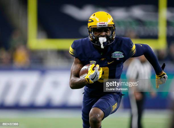 Wide receiver Diontae Johnson of the Toledo Rockets carries the ball against the Akron Zips during the first half at Ford Field on December 2 2017 in...