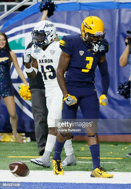 Wide receiver Diontae Johnson of the Toledo Rockets celebrates his touchdown catch against defensive back Denzel Butler of the Akron Zips during the...