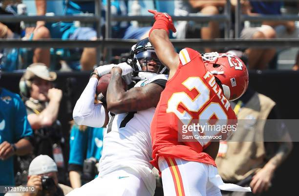 wide receiver DJ Chark of the Jacksonville Jaguars completes a reception against cornerback Kendall Fuller of the Kansas City Chiefs in the first...