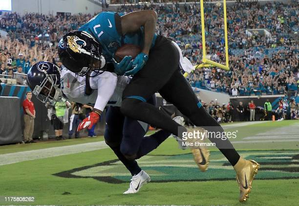 Wide receiver DJ Chark of the Jacksonville Jaguars scores a touchdown in the first quarter over Malcolm Butler of the Tennessee Titans during the...