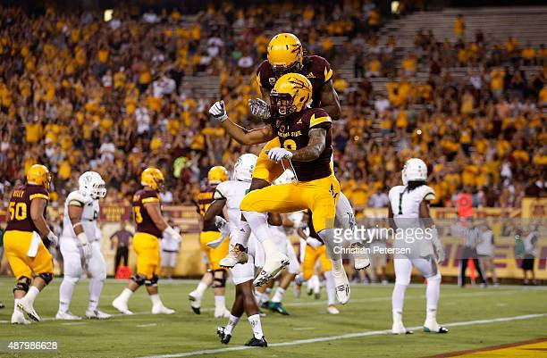 Wide receiver DJ Foster of the Arizona State Sun Devils celebrates with Gary Chambers after Foster caught a 14 yard touchdown reception against the...