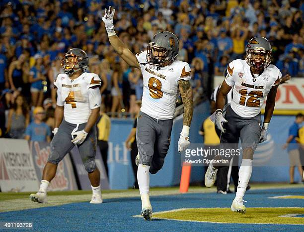 Wide receiver D.J. Foster of the Arizona State Sun Devils celebrates after scoring a touchdown against UCLA during the third quarter of the college...