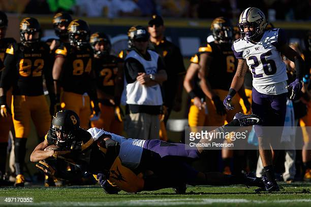 Wide receiver DJ Foster of the Arizona State Sun Devils dives with the football after a reception against the Washington Huskies during the fourth...
