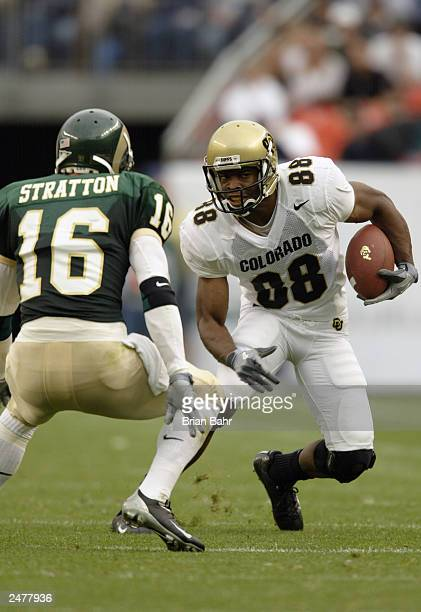 Wide receiver DJ JeHackett of the University of Colorado Buffaloes is pressured by Ben Stratton of the Colorado State University Rams during the game...