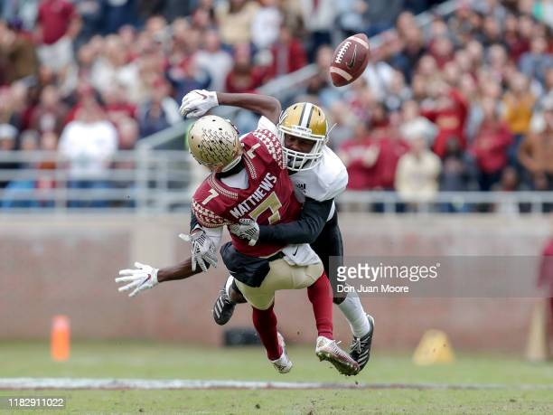 Wide Receiver DJ Matthews of the Florida State Seminoles fumbles after a catch after being hit by Defensive Back Kimar Martin of the Alabama State...