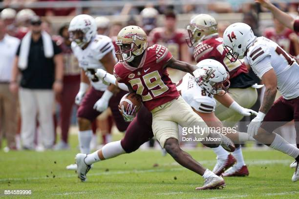 Wide Receiver DJ Matthews of the Florida State Seminoles runs a punt return back during the game against the Louisiana Monroe Warhawks at Doak...