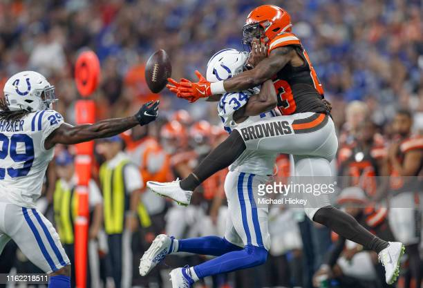 Wide receiver DJ Montgomery of the Cleveland Browns goes up for the passed ball as cornerback Rock YaSin of the Indianapolis Colts defends during the...