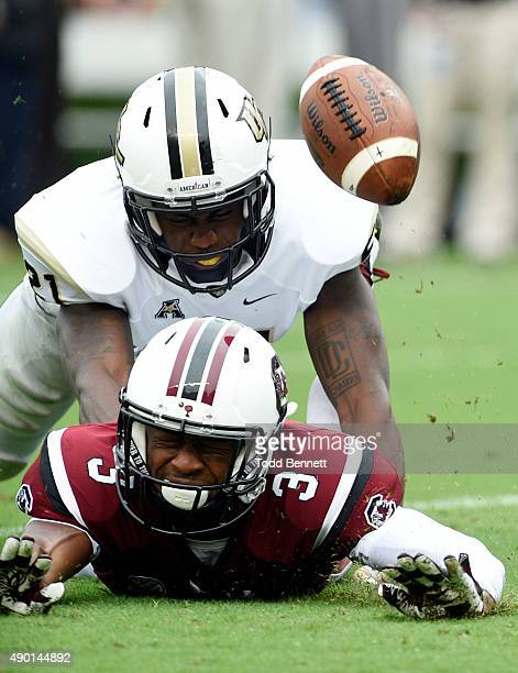 Wide receiver DJ Neal of the South Carolina Gamecocks has a reception broken up by defensive back Drico Johnson of the University of Central Florida...