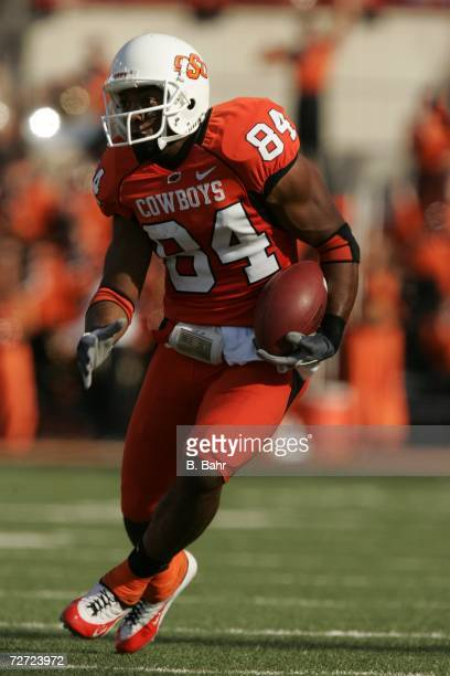 Wide receiver D'Juan Woods of the Oklahoma State Cowboys runs with a catch against the Oklahoma Sooners on November 25 2006 at Boone Pickens Stadium...