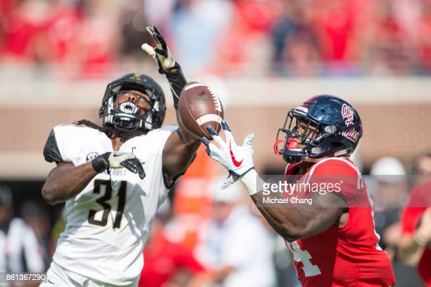 Wide receiver DK Metcalf of the Mississippi Rebels attempts to catch a pass in front of cornerback Tre Herndon of the Vanderbilt Commodores at...