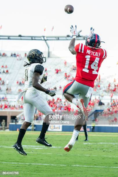 Wide receiver DK Metcalf of the Mississippi Rebels looks to catch a pass in front of cornerback Tre Herndon of the Vanderbilt Commodores at...