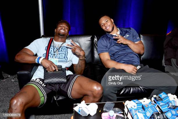 NFL wide receiver DK Metcalf of the Seattle Seahawks and NFL running back Saquon Barkley of the New York Giants attend day 2 of SiriusXM at Super...